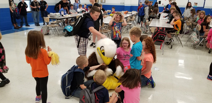 Cecil the eagle greets students.